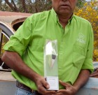 Francis Jupurrurla Kelly with his AFI award for Bush Mechanics